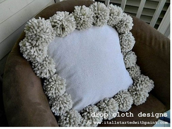 Pom Pillow in Chair with watermark