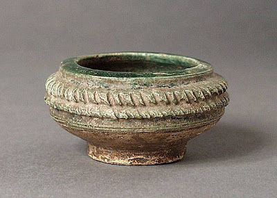 Miniature Bowl Afghanistan Miniature Bowl, 8th-9th century Ceramic; Vessel, Fritware, green glaze, carved, Diameter: 2 3/4 in. (6.99 cm) Gift of Andrew Hale and Kate Fitz Gibbon (AC1992.213.11) Art of the Middle East: Islamic Department.