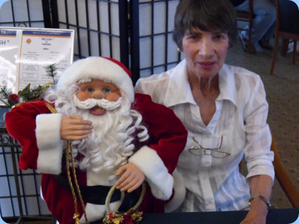 Role reversal! Santa Claus sitting on Colleen Kerr's knee.