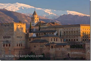 The Alhambra (La Alhambra) a moorish citadel and palace (designated a UNESCO World Heritage Site in 1984), backdropped by the snowcapped Sierra Nevada mountain range seen from Mirador de San Nicolas in the Albayzin district at sunset, City of Granada, Province of Granada, Andalusia (Andalucia), Spain, Europe.