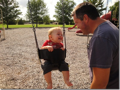 4.  Laughing and swinging with Daddy