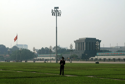 In the distance is Ho Chi Minh&#039;s Mausoleum, across the grass plains of death and embarrassment.