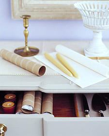Loose candles can get damaged easily when stored in drawers. Use paper-towel tubes -- the perfect size and shape -- to protect them. Wrap a pair of candles in tissue paper, then slip the package into a cardboard tube.