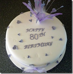 80th birthday cake with lilac feathers