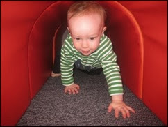 toddler-crawls-through-tunnel