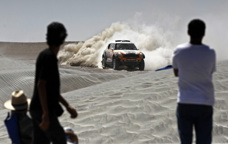 Mini driver Ricardo Leal Dos Santos and co-driver Paulo Fiuza, both from Portugal, compete in the 11th stage of the 2012 Argentina-Chile-Peru Dakar Rally between Arica, Chile and Arequipa, Peru, Thursday Jan. 12, 2012. (AP Photo/Martin Mejia)