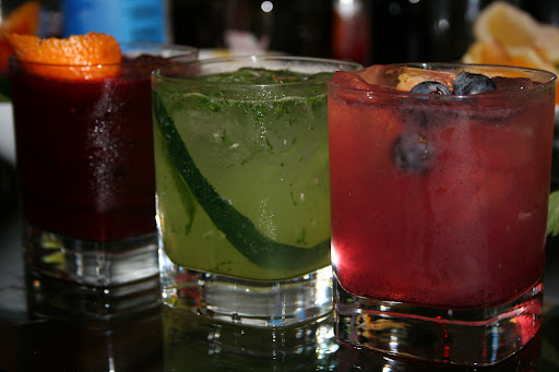 From left to right: A ruby red Beetroot Martini, a Cucumber Garden Gin and the Concord Grape