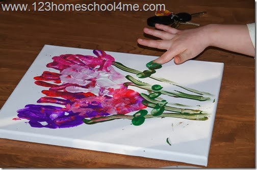 use finger to add stems and leaves with green paint