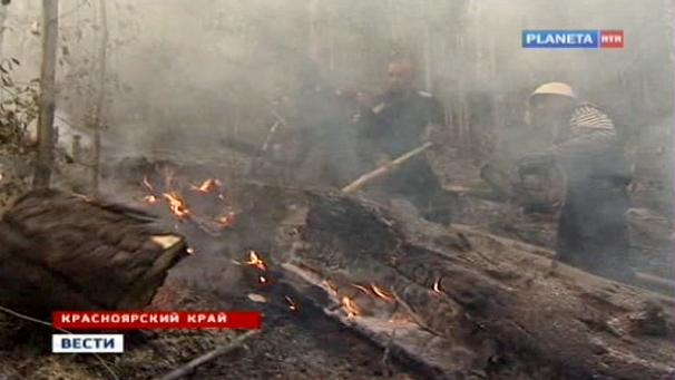 Firefighters battle flames in the Siberia forest, 9 August 2012. Planeta via UPI