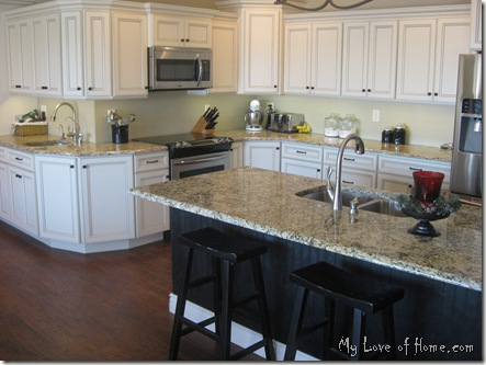 black island, white cabinets, granite