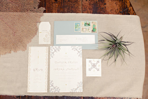 The invitation suite incorporated subtle nautical touches like a compass rose.