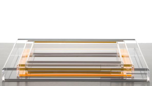 I love the subtle orange in these Lucite trays. (alexandravonfurstenburg.com)