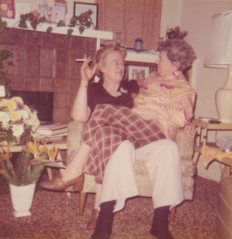 Dorothy Putnam celebrating her birthday, sitting on the lap of a friend. Undated.