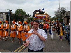 Jamie with flag at sikh festival