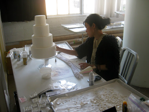 Katie was still working on the cake as the day wound down.