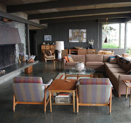 The dark walls and slate flooring here provide a perfect canvas for mauves and sunset oranges. (www.designsponge.com)