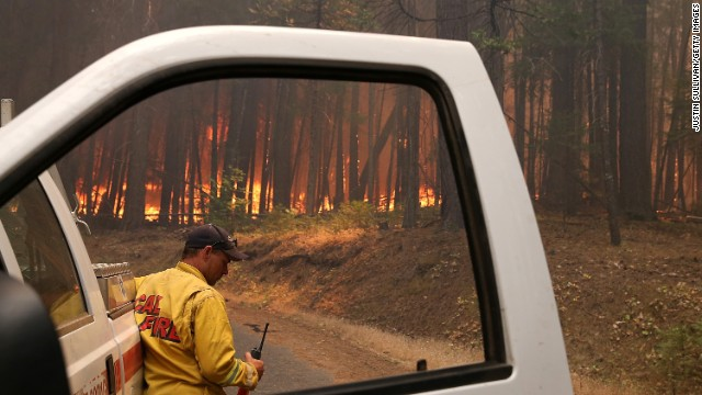 A Cal Fire firefighter monitors the Rim Fire as it burns through a stand of trees on Sunday, 25 August 2013, near Groveland, California. The fire had consumed nearly 134,000 acres as of Sunday. Photo: Justin Sullivan / Getty Images / CNN