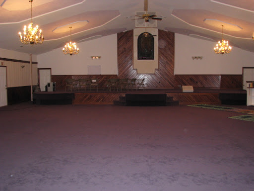 The building was formerly a church; it has a stage which is not used today.  (Photo credit:  Jennifer Moore)