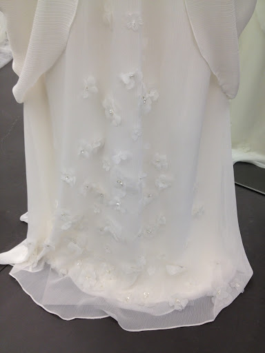 A beautiful floral detail on hem of this gown.