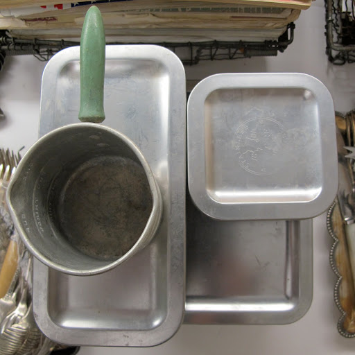 These are examples of stainless Revere Ware from the 50s or 60s. Fritz enjoys collecting different types of tupperware, as evidenced in our special issue–Boundless Beauty–which showcased a collection of vintage Pyrex containers.