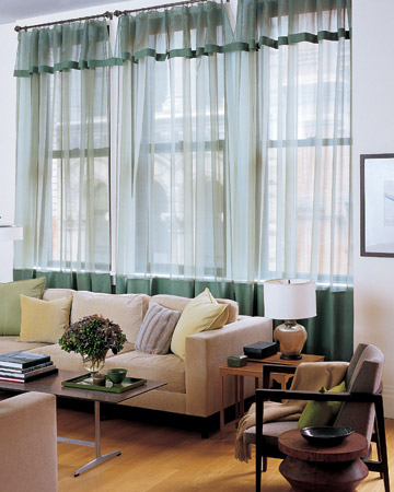 Create tone-on-tone sophistication by trimming silk-organza sheers with linen in a slightly deeper shade. Green linen panels on silk-organza sheers give just the right touch of color to a living room dressed in neutral hues.