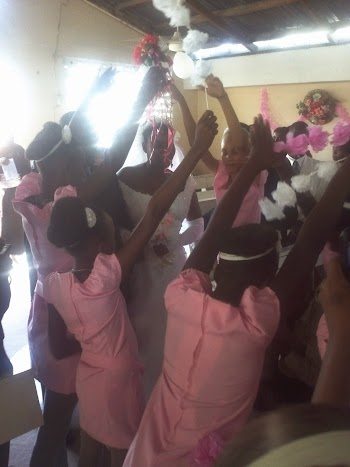 The dancing of girls coming down the isle at the haitian wedding