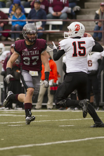 Jordan Tripp bum-rushes Idaho State senior quarterback Kevin Yost during the second quarter of Saturday's game.  Tripp was a key component to the Grizzly defensive machine, including an 80-yard touchdown on a fumble recovery late in the second quarter.  Washington-Grizly Stadium in Missoula, Mont., October 27th, 2012.