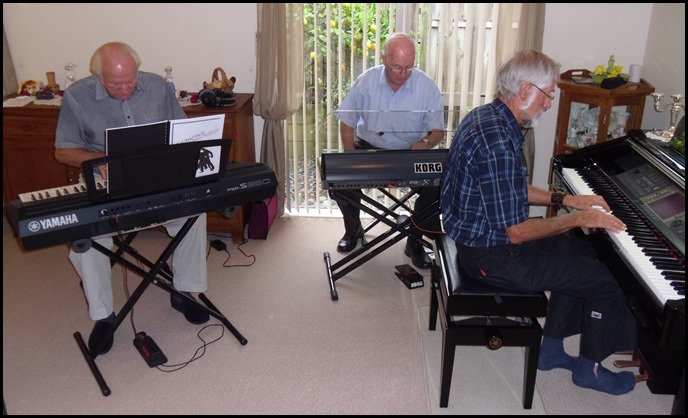 L to R: Rob Powell, Peter Brophy and Errol Storey having a jam session.