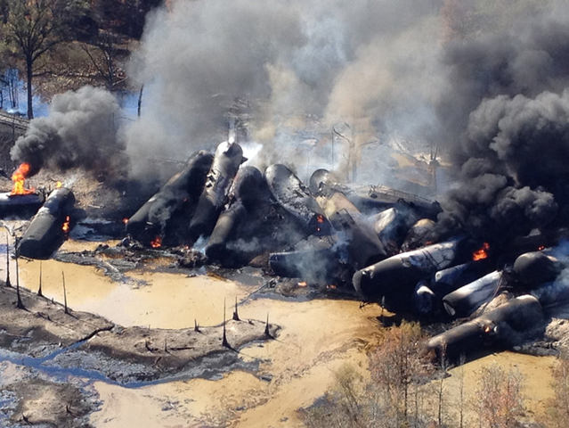 A tanker train that derailed and caught fire in western Alabama outside Aliceville was carrying 2.7 million gallons of crude oil, 9 November 2013. Photo: Bill Castle / Associated Press