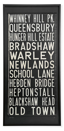 I love the idea of using fabrics or signs as wall art. This is a vintage framed UK trolley sign!  (roomandboard.com)
