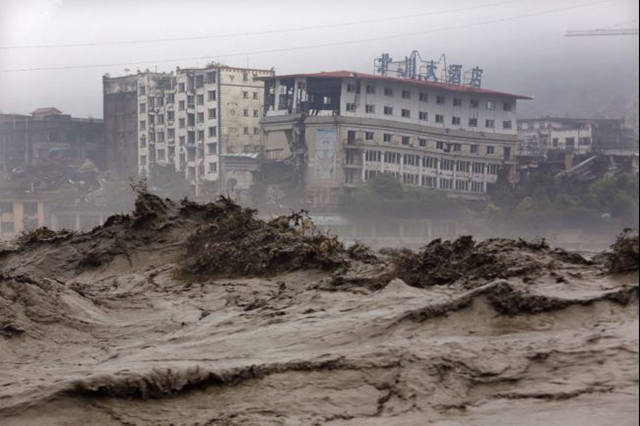 This picture, taken on 9 July 2013, shows heavy flood waters sweeping through Beichuan in southwest China's Sichuan province. Photo: AFP / Getty Images