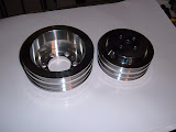 Billet pulleys, made in USA, 199.00 each. Replaces 1962-66 A/C 3 groove pulleys, will work on other nailheads, call.