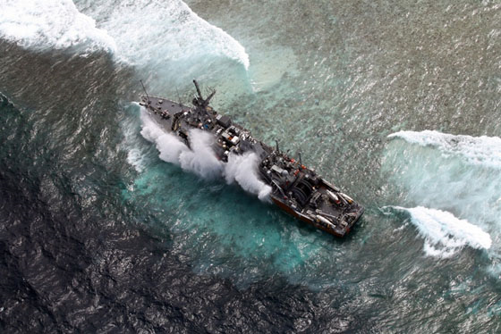 Aerial view of the US Navy ship USS Guardian aground on the Tubbataha Reef, western Philippines, on 19 January 2013. Photo: Armed Forces of the Philippines Western Command (AFP-WESCOM)