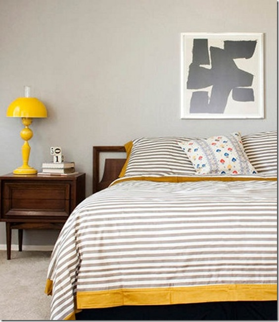 Modern bedroom with stripe bedding and a touch of yellow-design addict mom