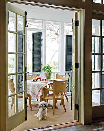 Classic shutter doors keep this Southern porch cool during the hottest months. (Martha Stewart Living)