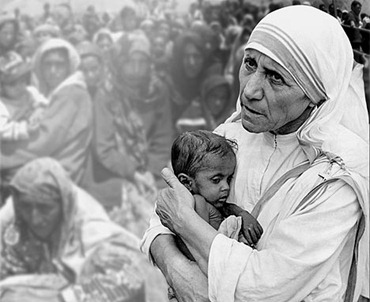 Mary Teresa of Calcutta holding a child