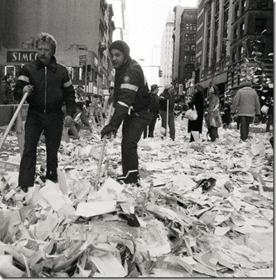 30 Jan 1981 --- Original caption: 1/30/1981-New York, NY- Two Department of Sanitation workers begin to sweep up the tons of confetti and ticker tape after the parade for the former American hostages on Broadway 1/30. --- Image by © Bettmann/CORBIS