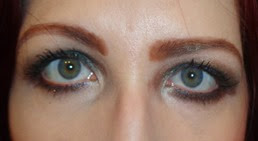 eyes with Laura Mercier Tempting Green eye shadow and Envy Creme Eyeliner_open