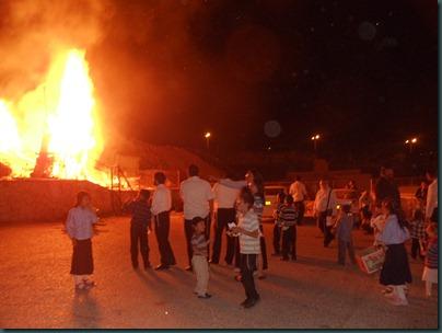 Lag Ba'Omer the children enjoy the bonfirel from a safe distance
