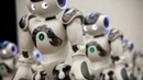 20 Nao Robots Dancing in Synchronized Harmony