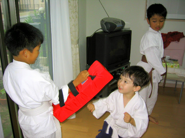 Kai learns some karate moves from Yasu and Hiro