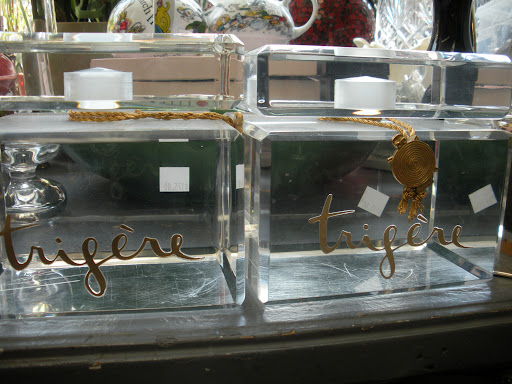 These were probably used for a perfume display, as they are very large. I think they would have a great second life as home decorating pieces though. They're so unique.