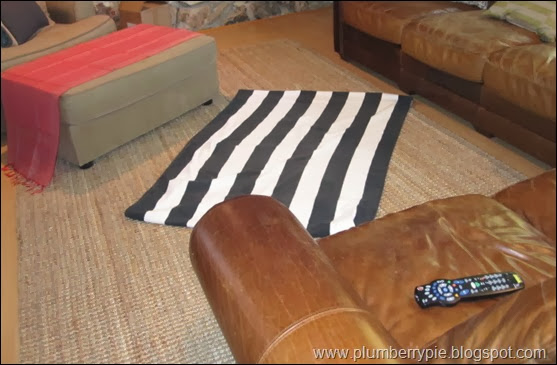 striped towel layered on rug