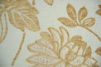 Tkanina obiciowa z efektem metalicznym w kwiaty. Złota.