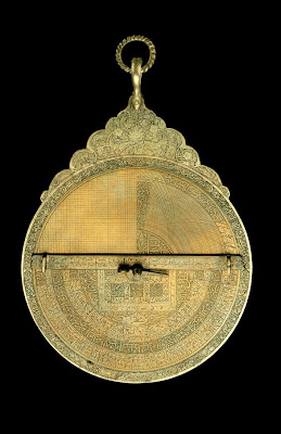 Astrolabe (forgery?) | Origin:  Iran | Period: late 19th century | Details:  Not Available | Type: Brass | Size: H: 20.1  W: 13.1   D: 3.1  cm | Museum Code: F1942.8a-h | Photograph and description taken from Freer and the Sackler (Smithsonian) Museums.