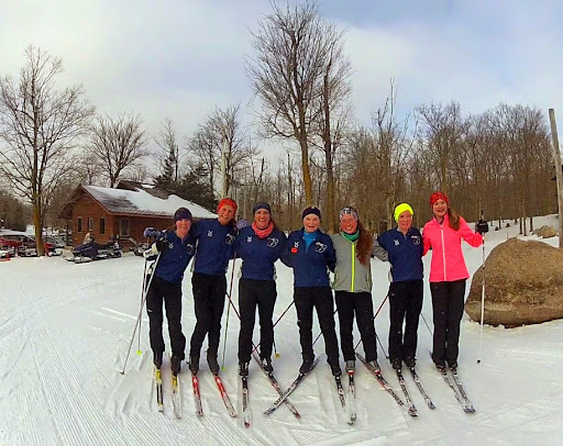 Bemidji girls varsity Nordic Ski team enjoying a day off from school on the trails checking out the Section course.