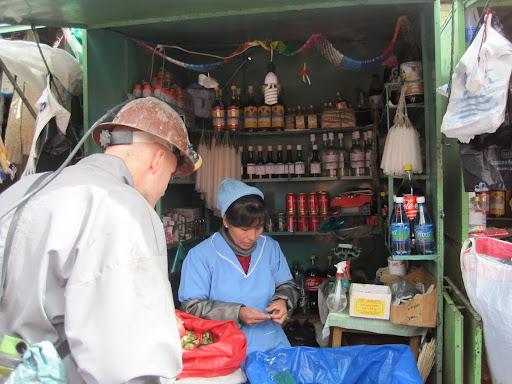 Erik buying supplies at the Miner's Market