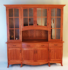 A traditional china cabinet with a shaker style