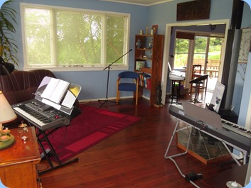 Starting to set-up our hosts' lovely lounge for the musical instrument invasion.
