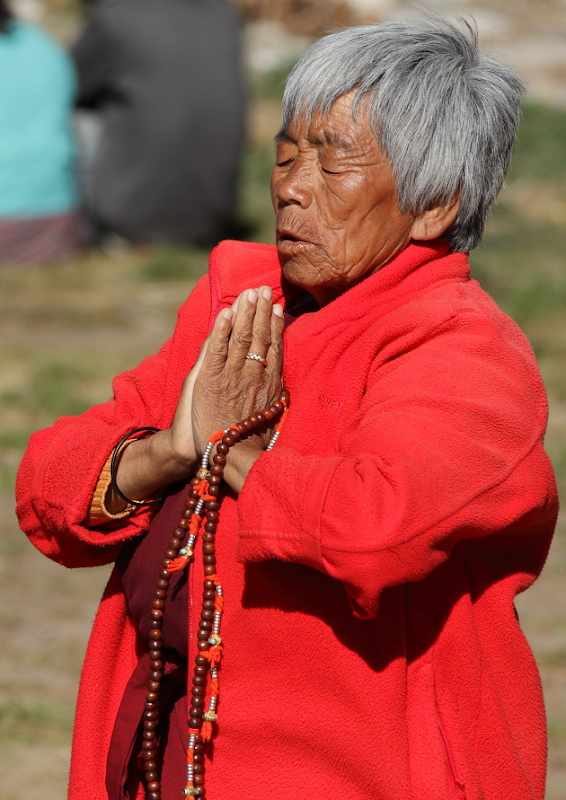 Bhutanese Woman in prayer
